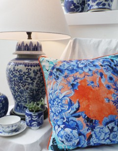 blue floral cushion cover in lifestyle shot