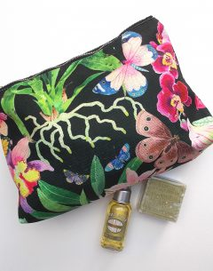 limited edition washbag in orchid print 100% polyester. Machine washable